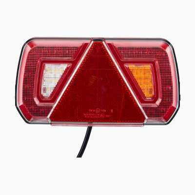 Rear lamp for trailer with integrated triangular reflector.